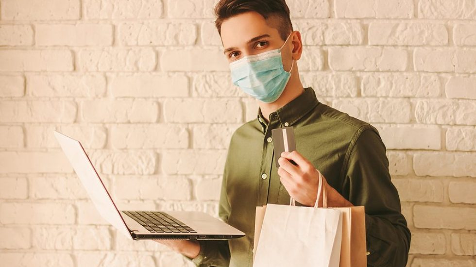 mystery-shopper-holding-bags-and-laptop