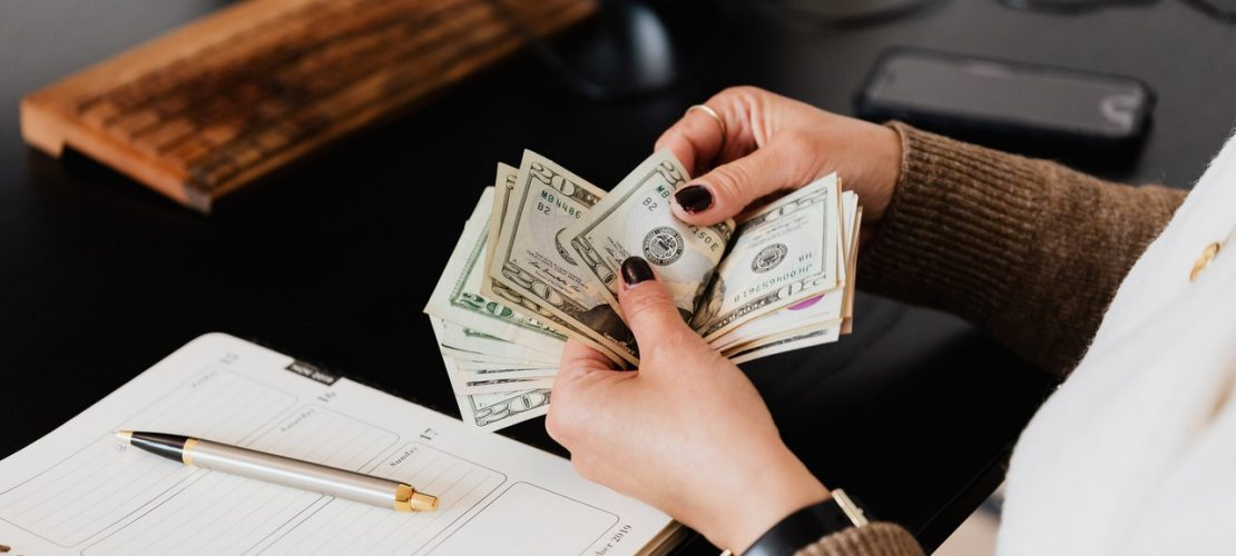 crop-woman-counting-money-at-modern-office-table-4475524