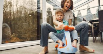 mother-and-son-riding-a-twist-car-3985233