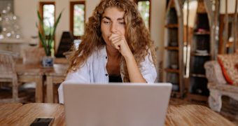 woman-in-white-button-up-shirt-while-using-laptop-4458424